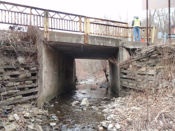 staff from mccormick taylor measures the bridge that carries street run