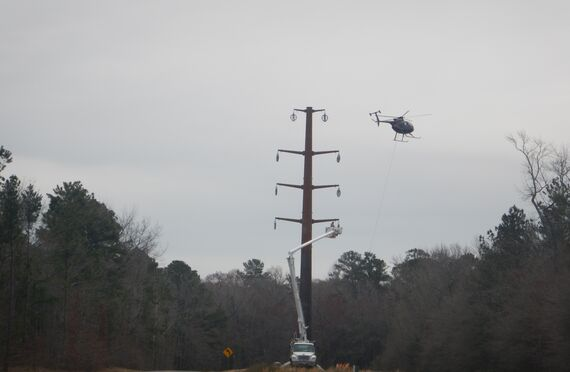 photo 3 transmission line installation using helicopter
